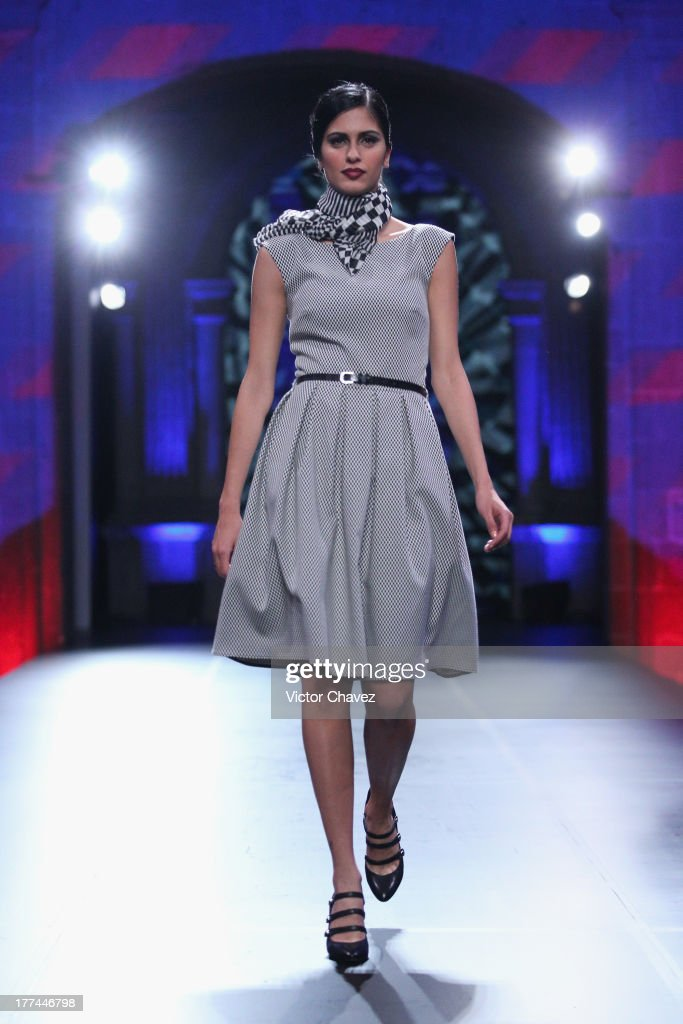 A model walks the runway during the Liverpool Fashion Fest Autumn/Winter 2013 at Club De Banqueros on August 22, 2013 in Mexico City, Mexico.
