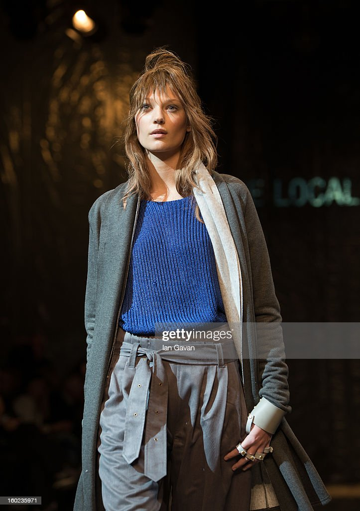 A model walks the runway during The Local Firm show at Mercedes-Benz Stockholm Fashion Week A/W 13 at Berns on January 28, 2013 in Stockholm, Sweden.