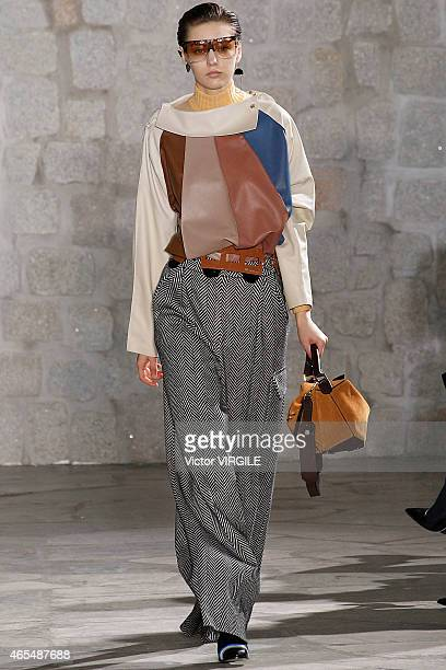 A model walks the runway during the Loewe show as part of the Paris Fashion Week Womenswear Fall/Winter 2015/2016 on March 6 2015 in Paris France