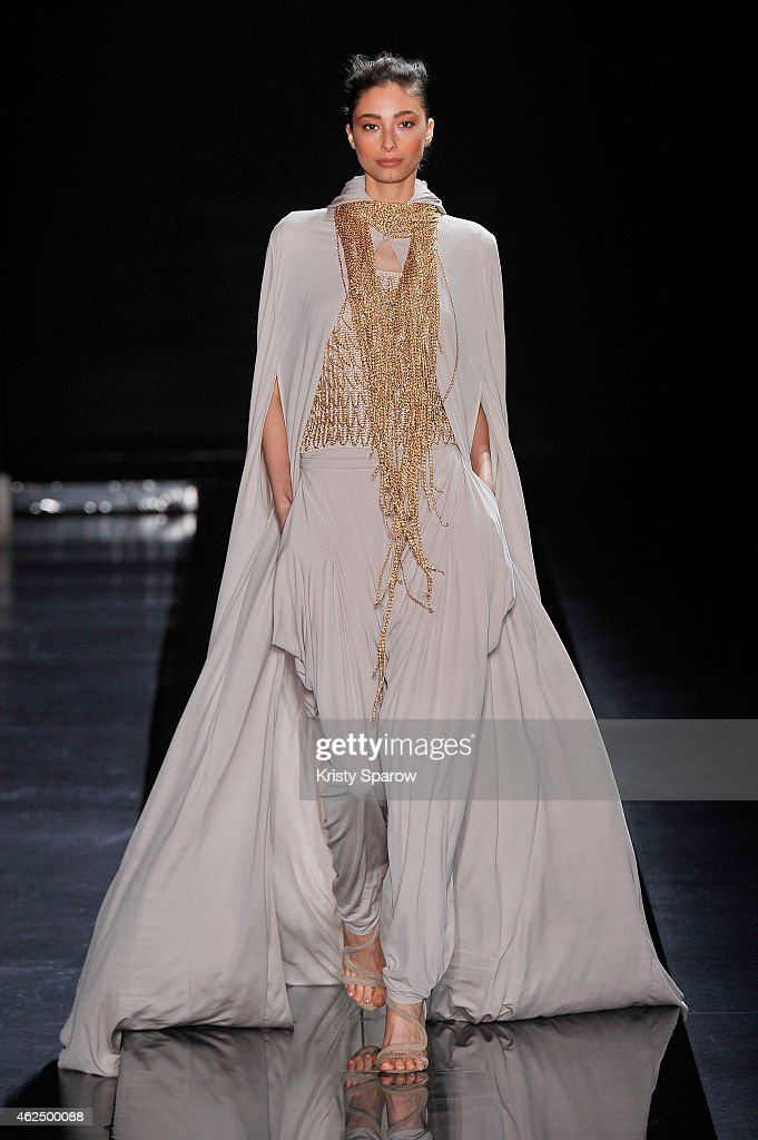 A model walks the runway during the Loris Azzaro show as part of Paris Fashion Week Haute Couture Spring/Summer 2015 at Couvent des Cordeliers on...