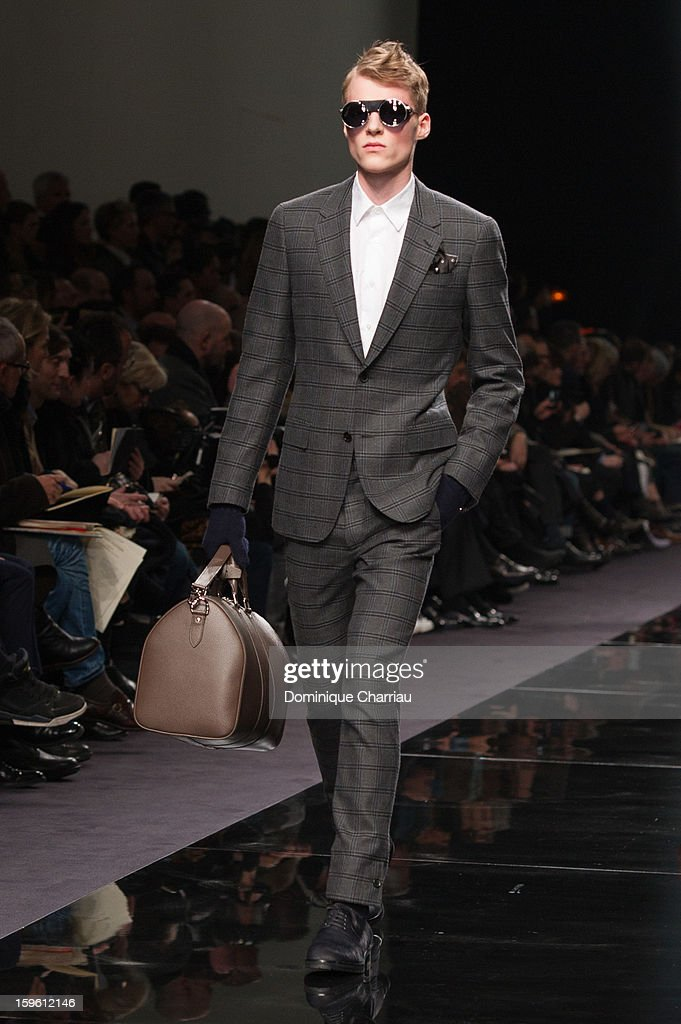 A model walks the runway during the Louis Vuitton Men Autumn / Winter 2013 show as part of Paris Fashion Week on at on January 17, 2013 in Paris, France.