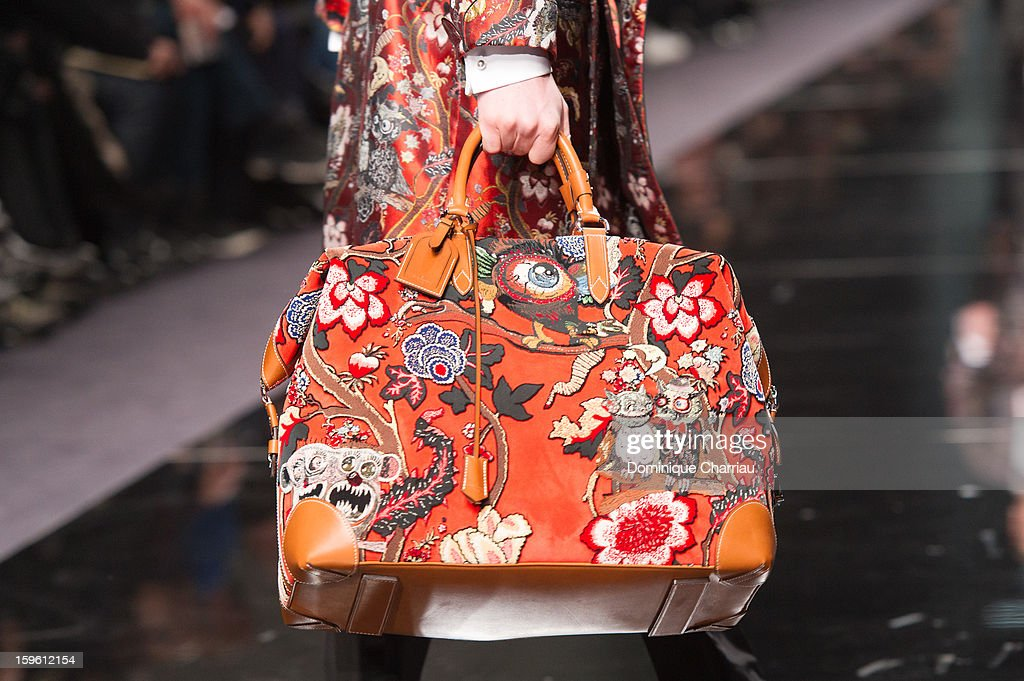 A model walks the runway (bag detail) during the Louis Vuitton Men Autumn / Winter 2013 show as part of Paris Fashion Week on at on January 17, 2013 in Paris, France.