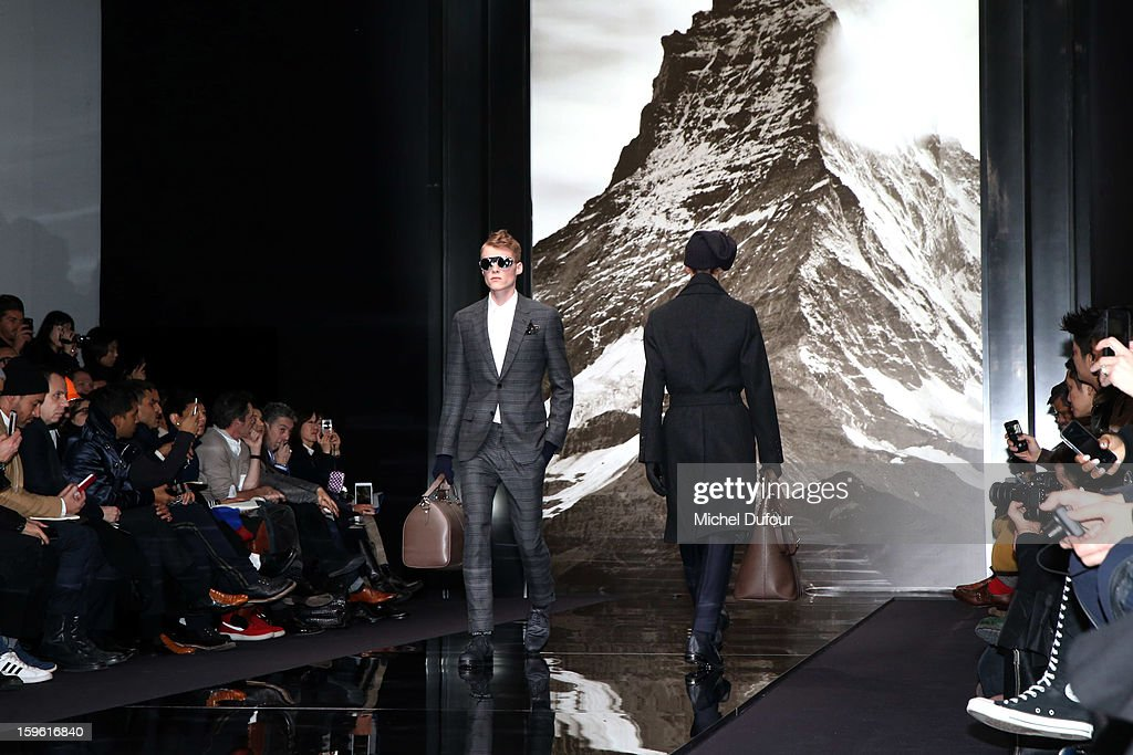 A model walks the runway during the Louis Vuitton Men Autumn / Winter 2013 show as part of Paris Fashion Week on January 17, 2013 in Paris, France.