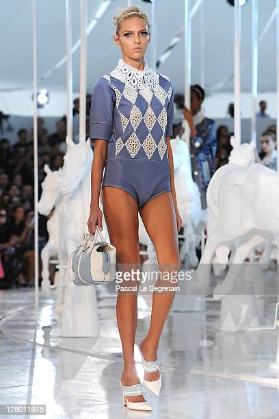 A model walks the runway during the Louis Vuitton Ready to Wear Spring / Summer 2012 show during Paris Fashion Week on October 5 2011 in Paris France