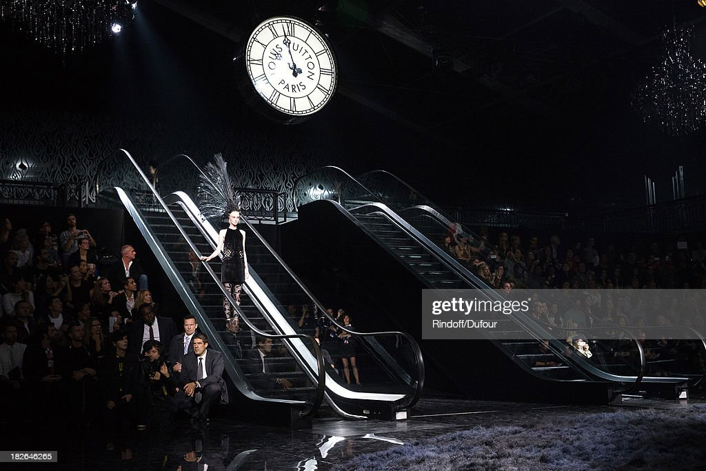 A model walks the runway during the Louis Vuitton show as part of the Paris Fashion Week Womenswear Spring/Summer 2014, held at Le Carre du Louvre on October 2, 2013 in Paris, France.