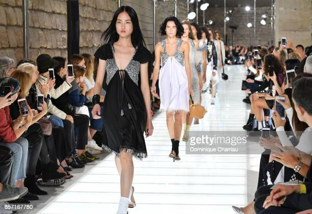 A model walks the runway during the Louis Vuitton show as part of the Paris Fashion Week Womenswear Spring/Summer 2018 on October 3 2017 in Paris...