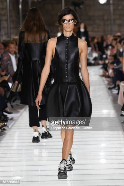 A model walks the runway during the Louis Vuitton Spring Summer 2018 show as part of Paris Fashion Week at Musee du Louvre on October 3 2017 in Paris...