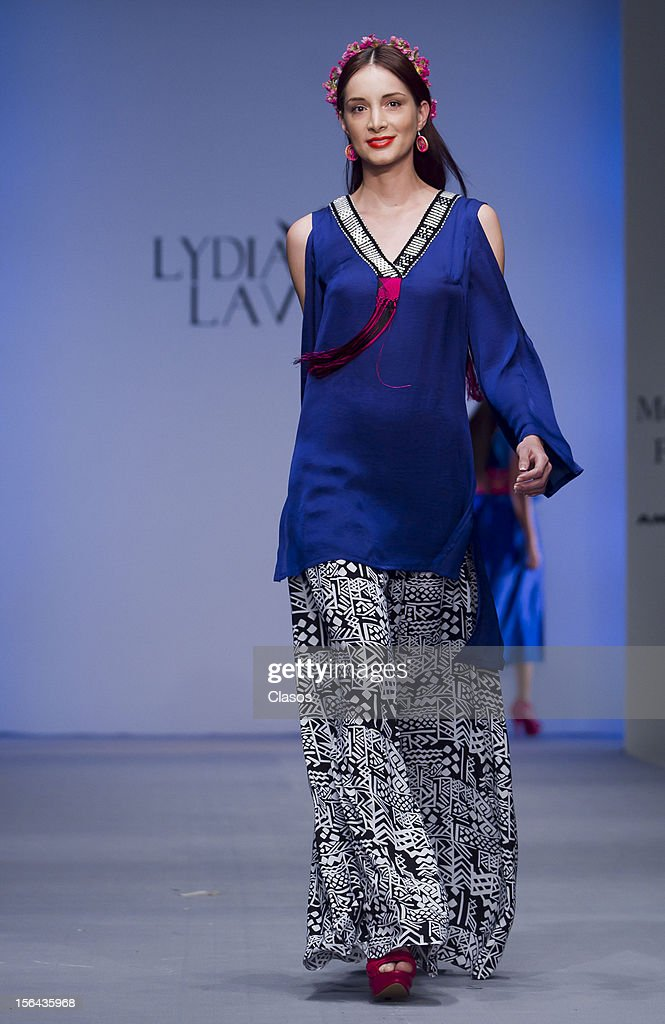 A model walks the runway during the Lydia Lavin Spring/Summer 2013 collection at Carpa Santa Fe on November 14, 2012 in Mexico City, Mexico.