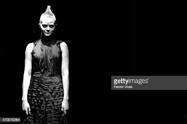A model walks the runway during the Macario Jimenez Show as part of MercedesBenz Fashion Week Mexico Fall/Winter 2015 day 3 at Campo Marte on April...