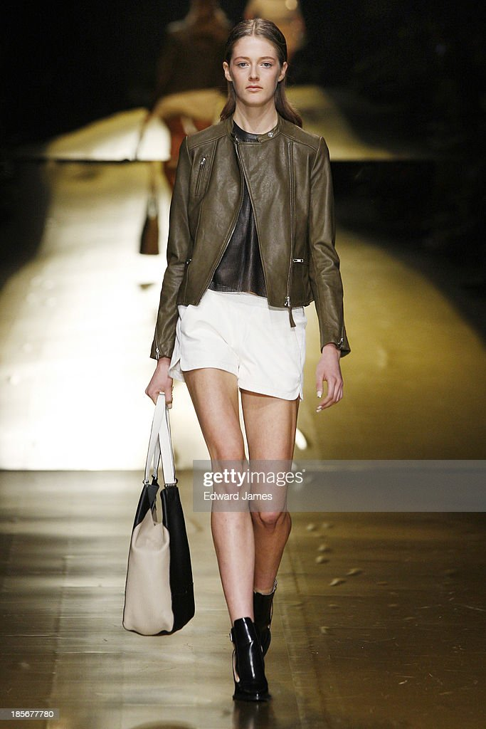 A model walks the runway during the Mackage fashion show at David Pecaut Square on October 23, 2013 in Toronto, Canada.