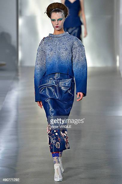 A model walks the runway during the Maison Margiela Ready to Wear show as part of the Paris Fashion Week Womenswear Spring/Summer 2016 on September...