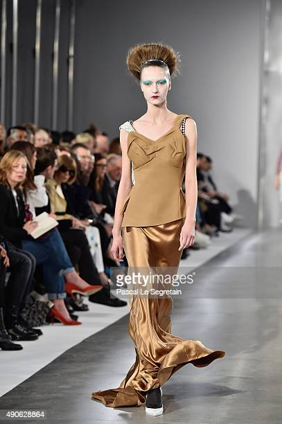 A model walks the runway during the Maison Margiela show as part of the Paris Fashion Week Womenswear Spring/Summer 2016 on September 30 2015 in...
