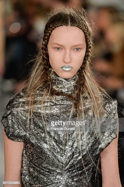 A model walks the runway during the Maison Margiela Spring Summer 2016 show as part of Paris Fashion Week on January 27 2016 in Paris France