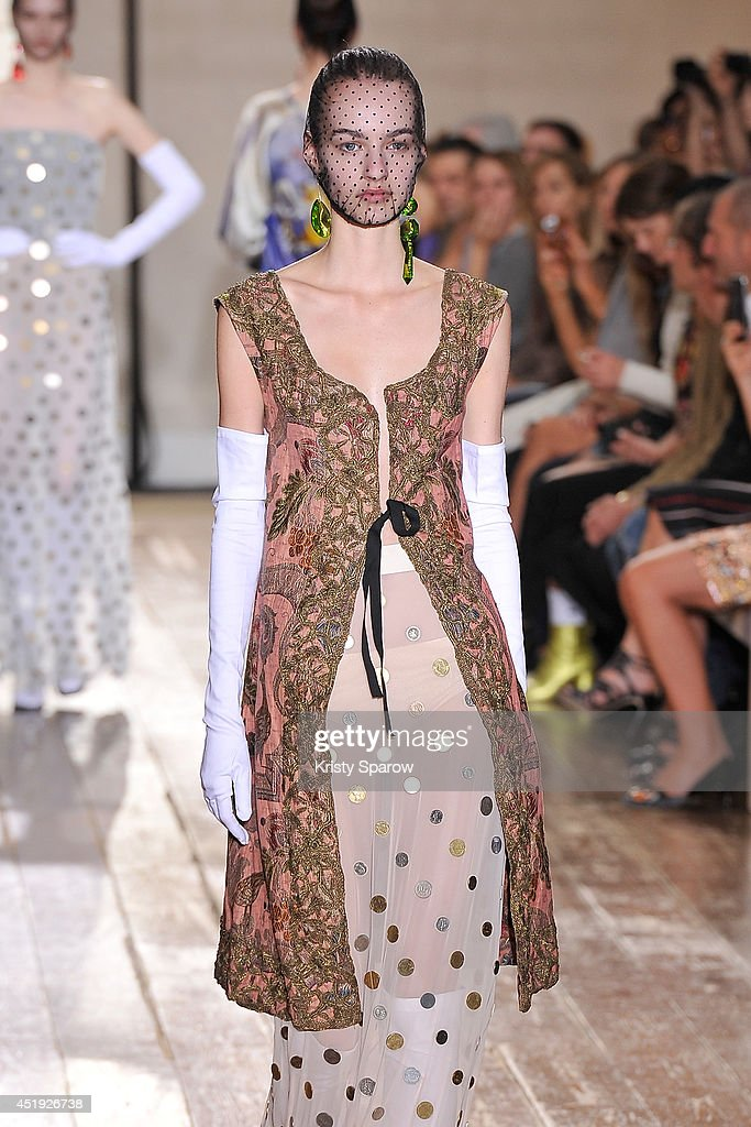 A model walks the runway during the Maison Martin Margiel show as part of Paris Fashion Week Haute Couture Fall/Winter 20142015 on July 9 2014 in...