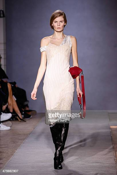 A model walks the runway during the Maison Martin Margiela at show as part of the Paris Fashion Week Womenswear Fall/Winter 20142015 at Hotel Salomon...