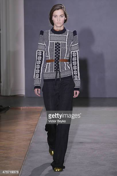 A model walks the runway during the Maison Martin Margiela at show as part of the Paris Fashion Week Womenswear Fall/Winter 20142015 on February 28...