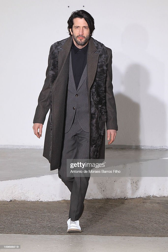 A model walks the runway during the Maison Martin Margiela Men Autumn / Winter 2013 show as part of Paris Fashion Week on at Garage Turenne on January 18, 2013 in Paris, France.