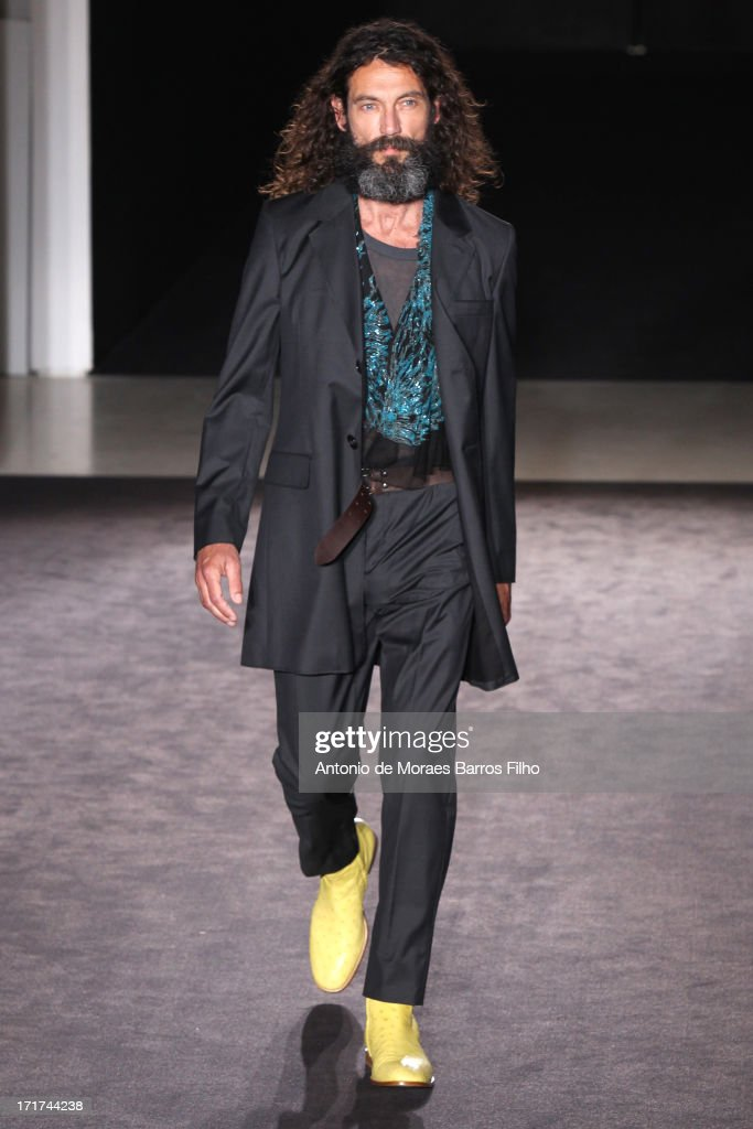 A model walks the runway during the Maison Martin Margiela Menswear Spring/Summer 2014 Show As Part Of The Paris Fashion Week on June 28, 2013 in Paris, France.