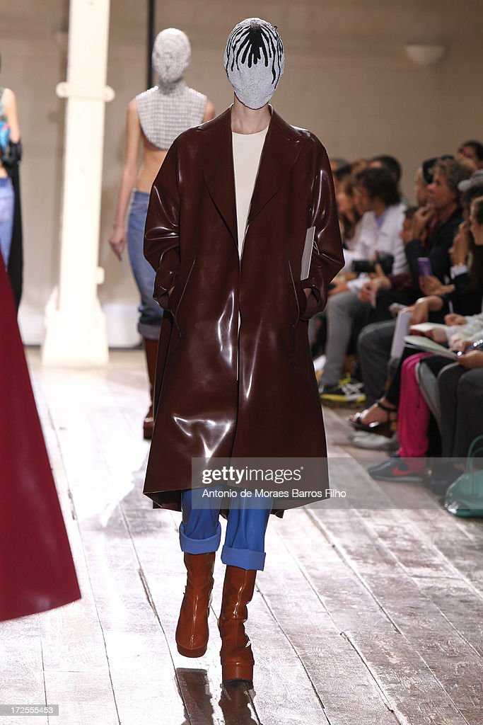 A model walks the runway during the Maison Martin Margiela show as part of Paris Fashion Week Haute-Couture Fall/Winter 2013-2014 at on July 3, 2013 in Paris, France.
