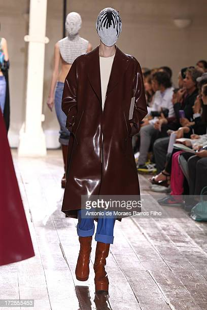 A model walks the runway during the Maison Martin Margiela show as part of Paris Fashion Week HauteCouture Fall/Winter 20132014 at on July 3 2013 in...