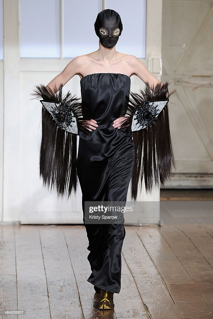 A model walks the runway during the Maison Martin Margiela show as part of Paris Fashion Week Haute Couture Spring/Summer 2014 on January 22, 2014 in Paris, France.