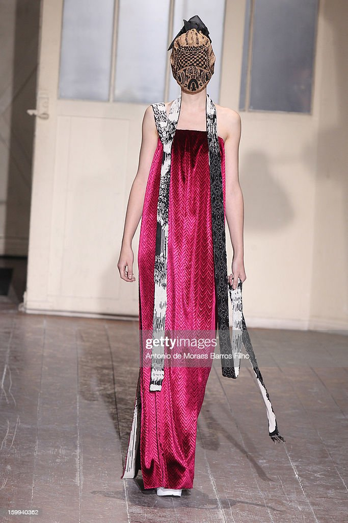A model walks the runway during the Maison Martin Margiela Spring/Summer 2013 Haute-Couture show as part of Paris Fashion Week at on January 23, 2013 in Paris, France.