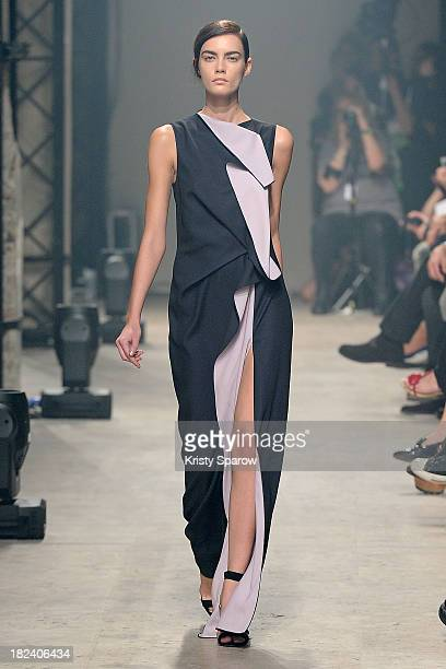 A model walks the runway during the Maison Rabih Kayrouz show as part of Paris Fashion Week Womenswear Spring/Summer 2014 on September 29 2013 in...