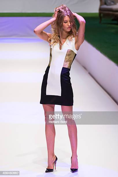 A model walks the runway during the Maison Sevigne show as part of the Paris Fashion Week Womenswear Spring/Summer 2015 at 'Carrousel du Louvre' on...