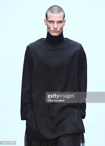 A model walks the runway during the MAN show at the London Collections Men AW15 at The Old Sorting Office on January 9 2015 in London England