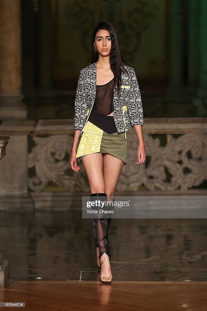 A model walks the runway during the Mancandy Spring/Summer 2013 fashion show at Casino Español on November 27, 2012 in Mexico City, Mexico.