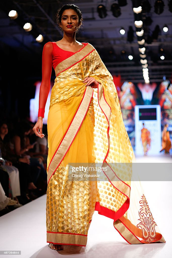 A model walks the runway during the <a gi-track='captionPersonalityLinkClicked' href=/galleries/search?phrase=Mandira+Bedi&family=editorial&specificpeople=703799 ng-click='$event.stopPropagation()'>Mandira Bedi</a> show on day 5 of Lakme Fashion Week Summer/Resort 2015 at Palladium Hotel on March 22, 2015 in Mumbai, India.