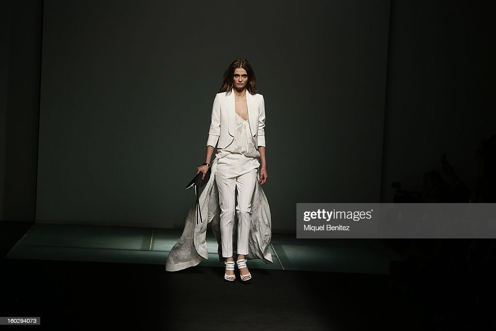 A model walks the runway during the Mango fashion show as part of the 080 Barcelona Fashion Week Autumn/Winter 2013-2014 on January 28, 2013 in Barcelona, Spain.
