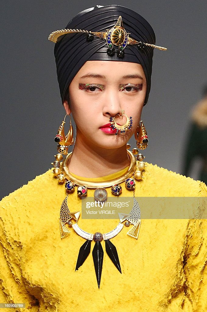 A model walks the runway during the Manish Arora Ready to Wear Fall/Winter 2013-2014 show as part of the Paris Fashion Week on February 28, 2013 in Paris, France.