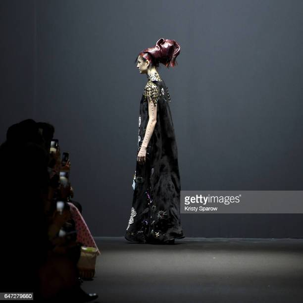 A model walks the runway during the Manish Arora show as part of Paris Fashion Week Womenswear Fall/Winter 2017/2018 on March 2 2017 in Paris France