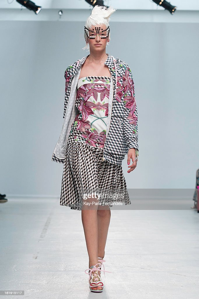 A model walks the runway during the Manish Arora show as part of the Paris Fashion Week Womenswear Spring/Summer 2014 at the Palais De Tokyo on September 26, 2013 in Paris, France.