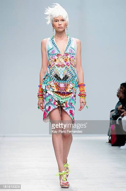 A model walks the runway during the Manish Arora show as part of the Paris Fashion Week Womenswear Spring/Summer 2014 at the Palais De Tokyo on...