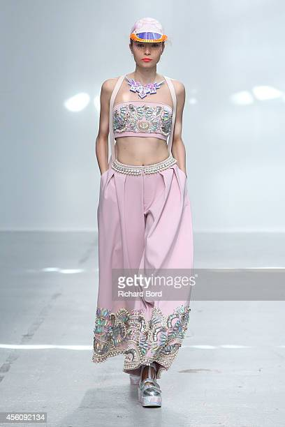 A model walks the runway during the Manish Arora show as part of the Paris Fashion Week Womenswear Spring/Summer 2015 on September 25 2014 in Paris...