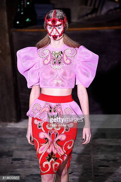 A model walks the runway during the Manish Arora show as part of the Paris Fashion Week Womenswear Fall/Winter 2016/2017 on March 3 2016 in Paris...