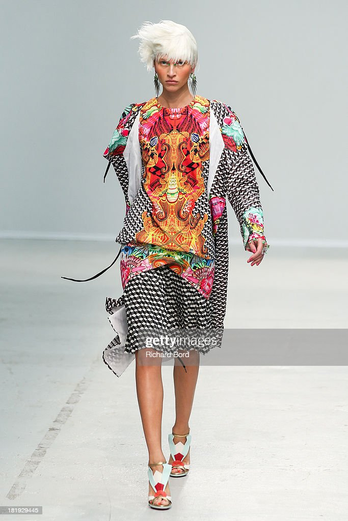 A model walks the runway during the Manish Arora show at Palais de Tokyo as part of the Paris Fashion Week Womenswear Spring/Summer 2014 on September 26, 2013 in Paris, France.
