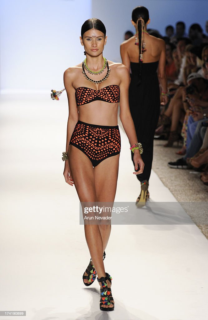 A model walks the runway during the Mara Hoffman Swim fashion show at Mercedes-Benz Fashion Week Swim 2014 at Raleigh Hotel on July 20, 2013 in Miami Beach, Florida.