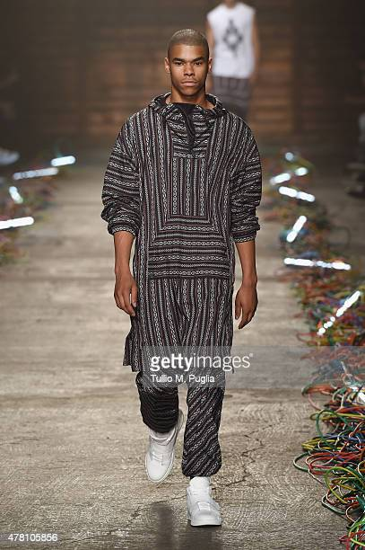 A model walks the runway during the Marcelo Burlon County of Milan fashion show as part of Milan Men's Fashion Week Spring/Summer 2016 on June 22...