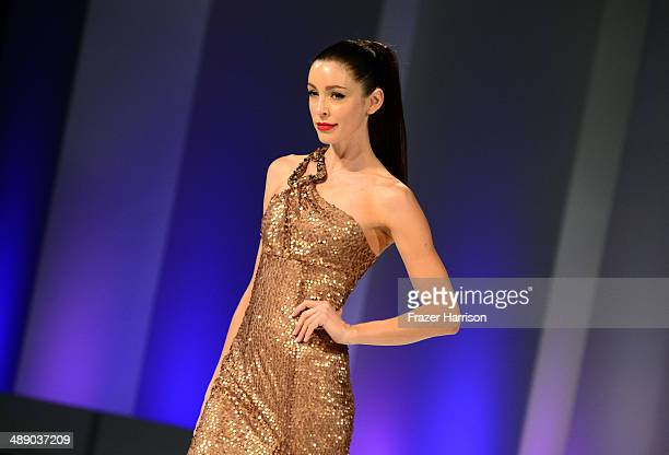 A model walks the runway during the Margi Kent fashion show as part of The Helping Hand of Los Angeles Mother's Day Luncheon at The Beverly Hilton...