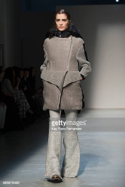 A model walks the runway during the Masha Ma show as part of the Paris Fashion Week Womenswear Fall/Winter 2015/2016 on March 11 2015 in Paris France