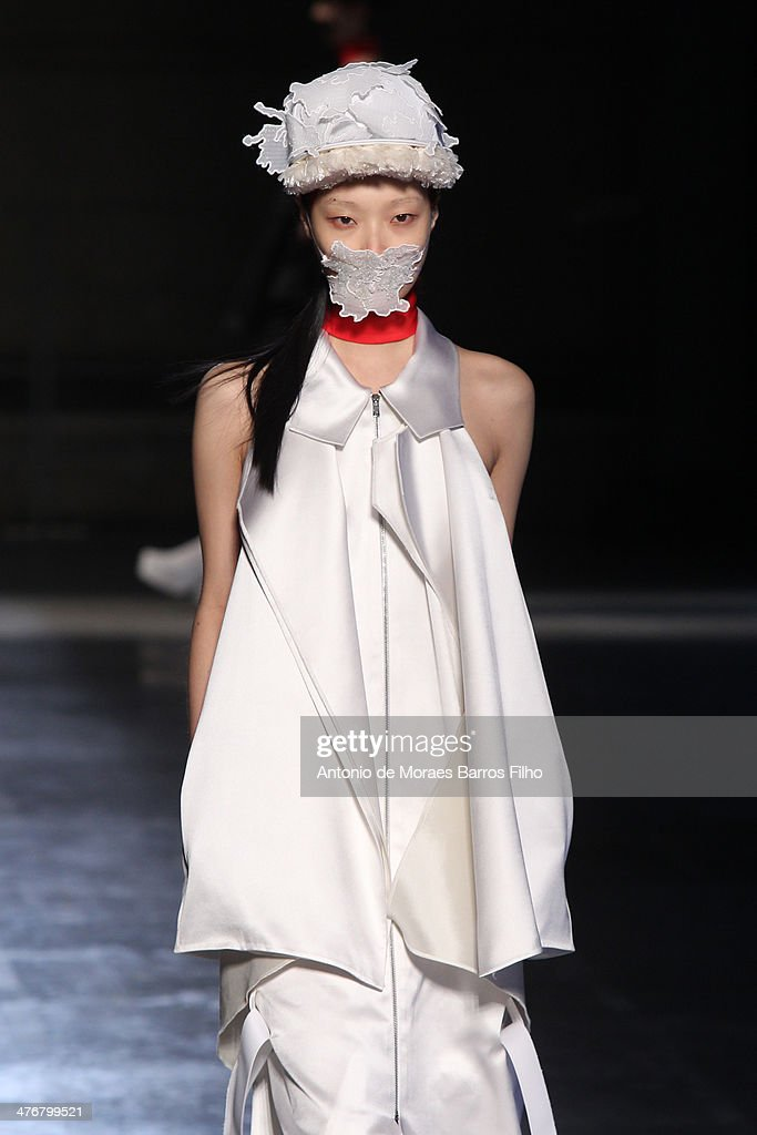 A model walks the runway during the Masha Ma show as part of the Paris Fashion Week Womenswear Fall/Winter 2014-2015 on March 5, 2014 in Paris, France.