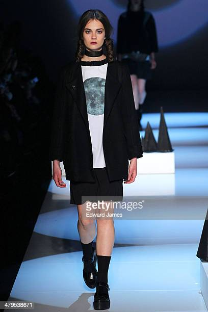 A model walks the runway during the Matiere Noir fashion show during World Mastercard fashion week on March 18 2014 in Toronto Canada