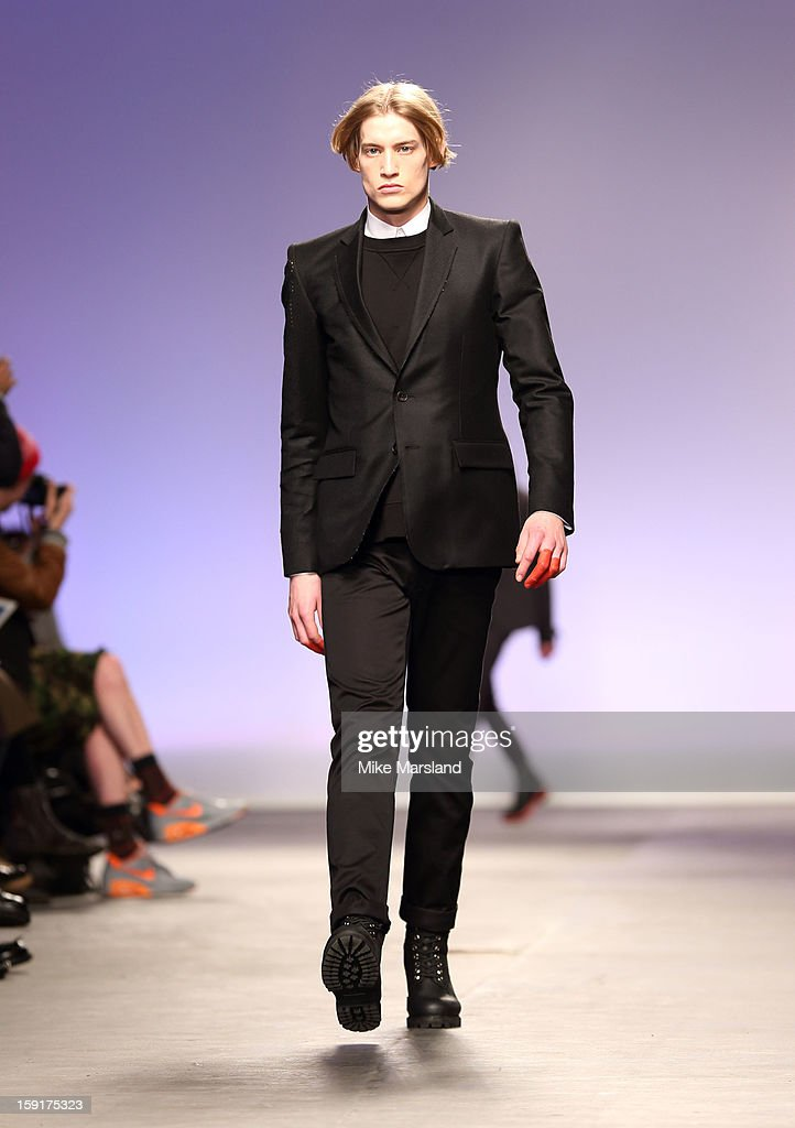 A model walks the runway during the Matthew Miller show at the London Collections: MEN AW13 at The Old Sorting Office on January 9, 2013 in London, England.
