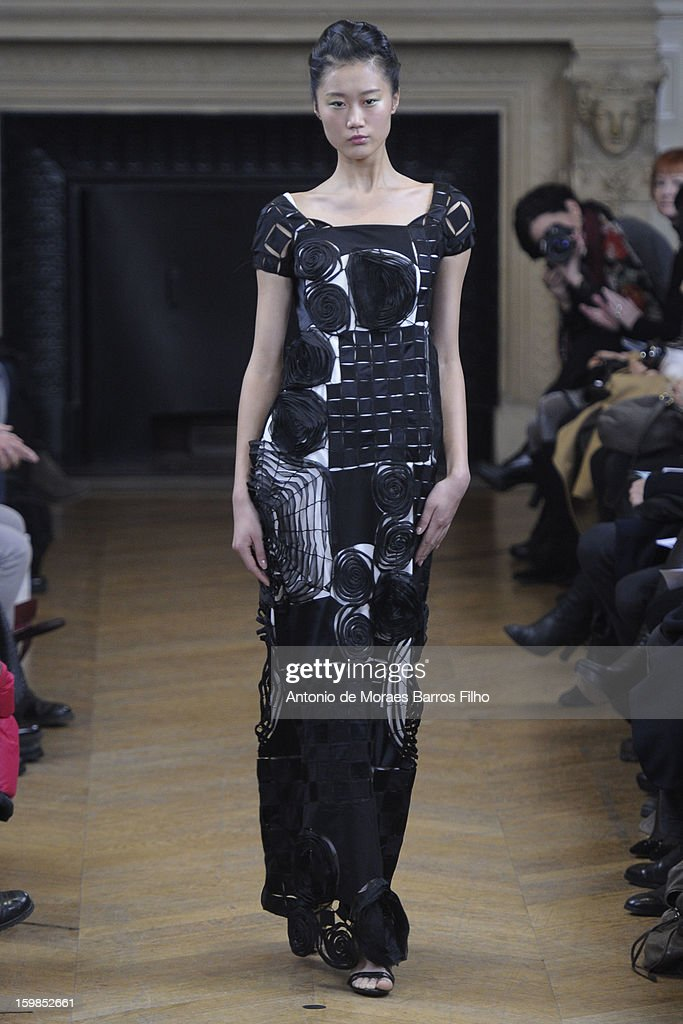 A model walks the runway during the Maurizio Galante show at Theatre du Chatelet on January 21, 2013 in Paris, France.