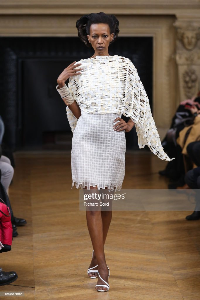 A model walks the runway during the Maurizio Galante Spring/Summer 2013 Haute-Couture show as part of Paris Fashion Week at Theatre du Chatelet on January 21, 2013 in Paris, France.