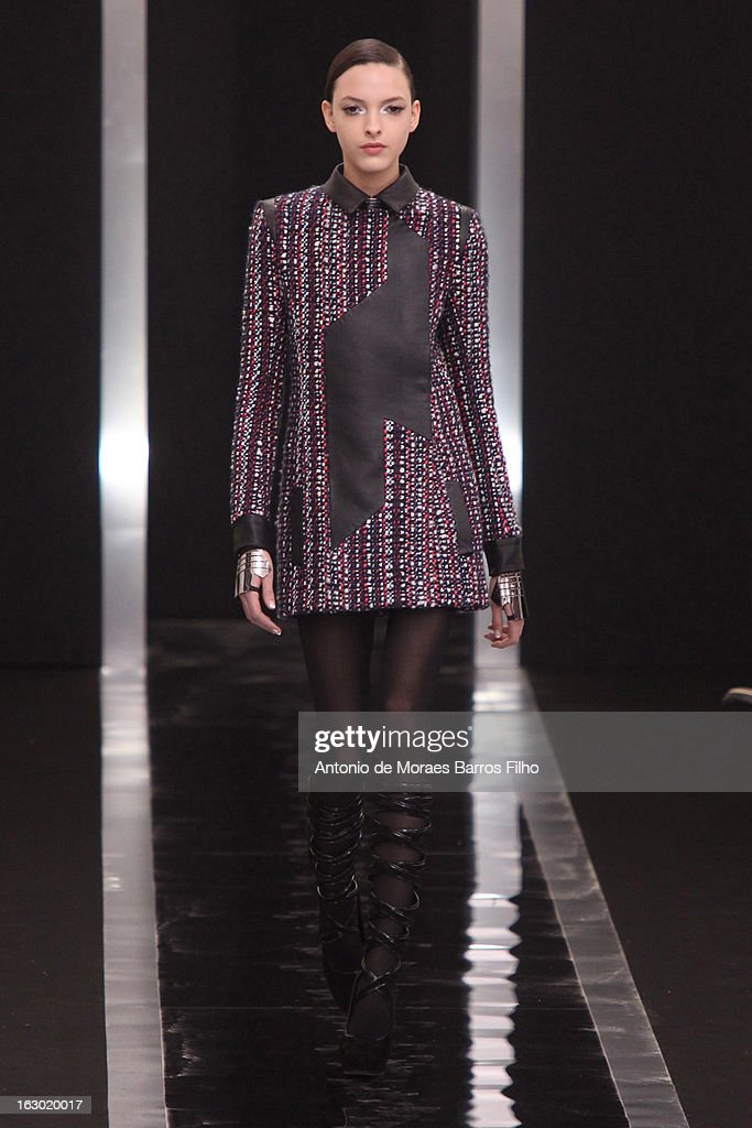 A model walks the runway during the Maxime Simoens Fall/Winter 2013 Ready-to-Wear show as part of Paris Fashion Week on March 3, 2013 in Paris, France.