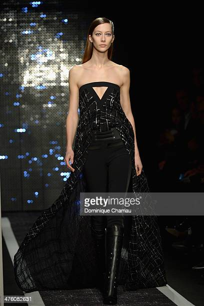 A model walks the runway during the Maxime Simoens show as part of the Paris Fashion Week Womenswear Fall/Winter 20142015 on March 2 2014 in Paris...